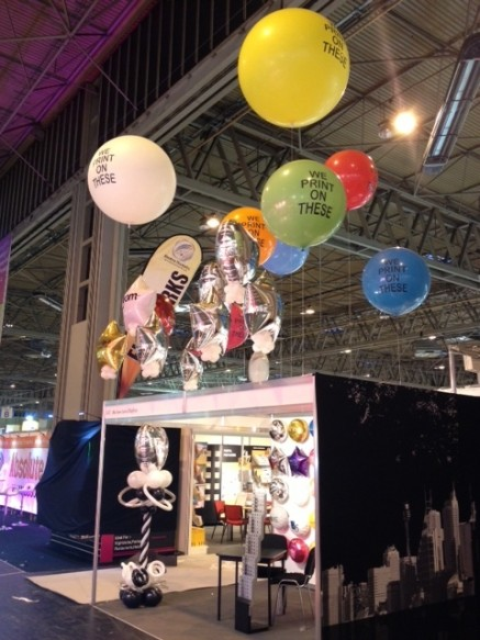 3ft, 4ft and 5.5ft balloons above and exhibition stand in 2013