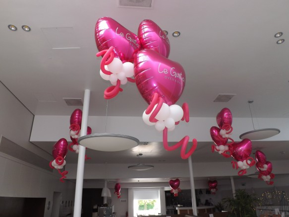 "Giant 36"" air filled foil hearts hang from the ceiling"
