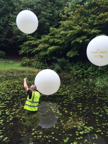 Staying dry was not an option as the client was very precise about the positioning of each balloon