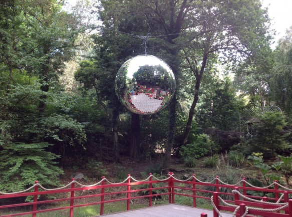 A 6ft Mirror Ball suspended over the floating dance floor on the lake