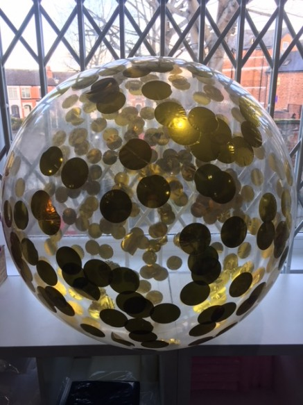 """Giant metallic confetti. A simple and stunning effect when added to 36"""" clear latex balloons"""